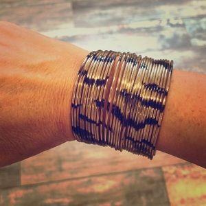 Tiger striped metal cuff bracelet